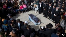 Family and friends of Israeli Dafna Meir attend her funeral in a cemetery in Jerusalem, Jan. 18, 2016.