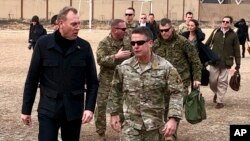 Acting Defense Secretary Pat Shanahan, left, arrives in Kabul, Afghanistan, Feb. 11, 2019, to consult with Army Gen. Scott Miller, right, commander of U.S. and coalition forces, and senior Afghan government leaders.