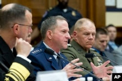 Air Force Chief of Staff Gen. David L. Goldfein, flanked by Marine Corps Commandant Gen. Robert B. Neller, right, testifies on Capitol Hill in Washington, April 5, 2017.