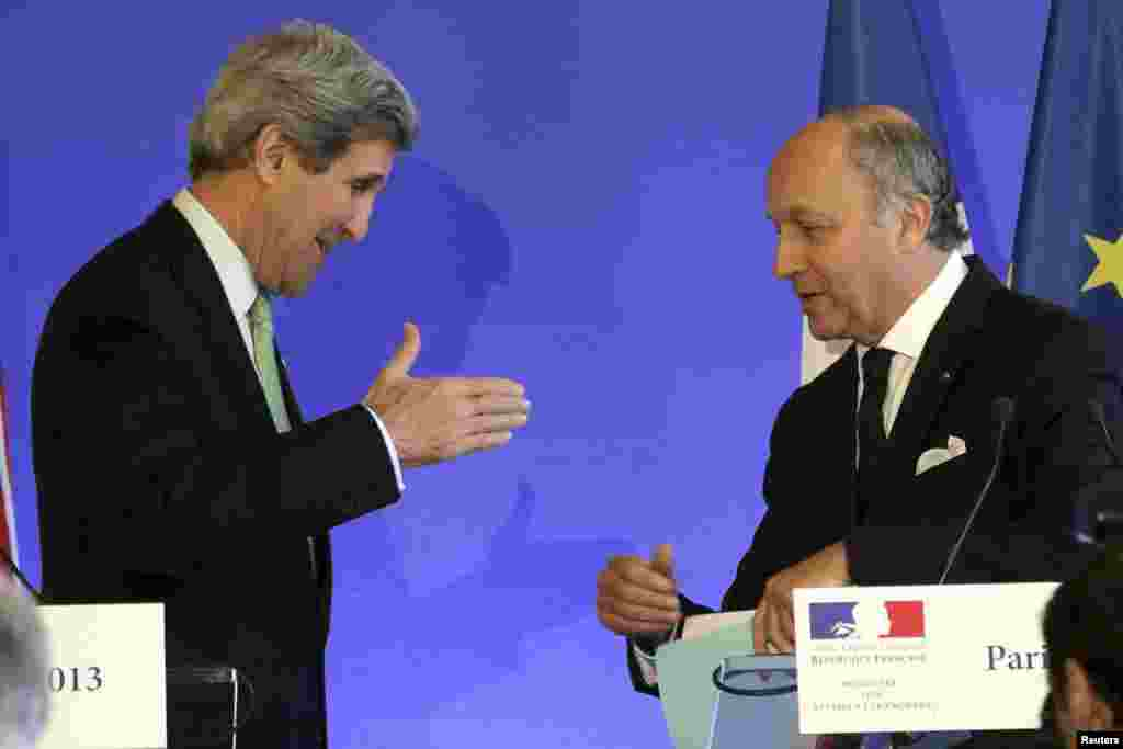 French Foreign Affairs minister Laurent Fabius (R) speaks with U.S. Secretary of State John Kerry following a news conference at the ministry in Paris, February 27, 2013. REUTERS/Philippe Wojazer (FRANCE) - RTR3ECNE