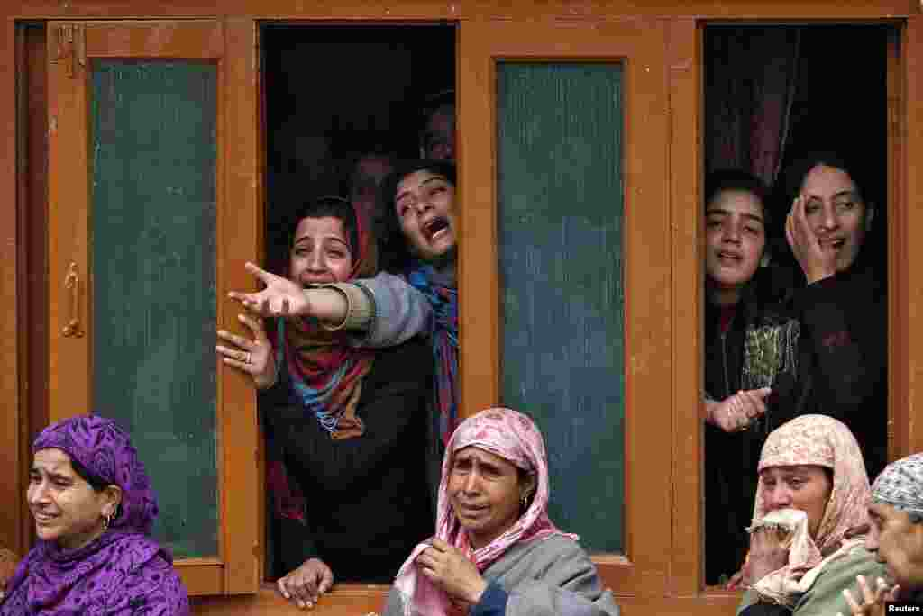 Relatives of Javed Ahmed Wani, a village council chief, mourn during his funeral in Kalantra village, north of Srinagar, India. Wani was shot dead by suspected militants Sunday outside his home, police said. (Reuters)