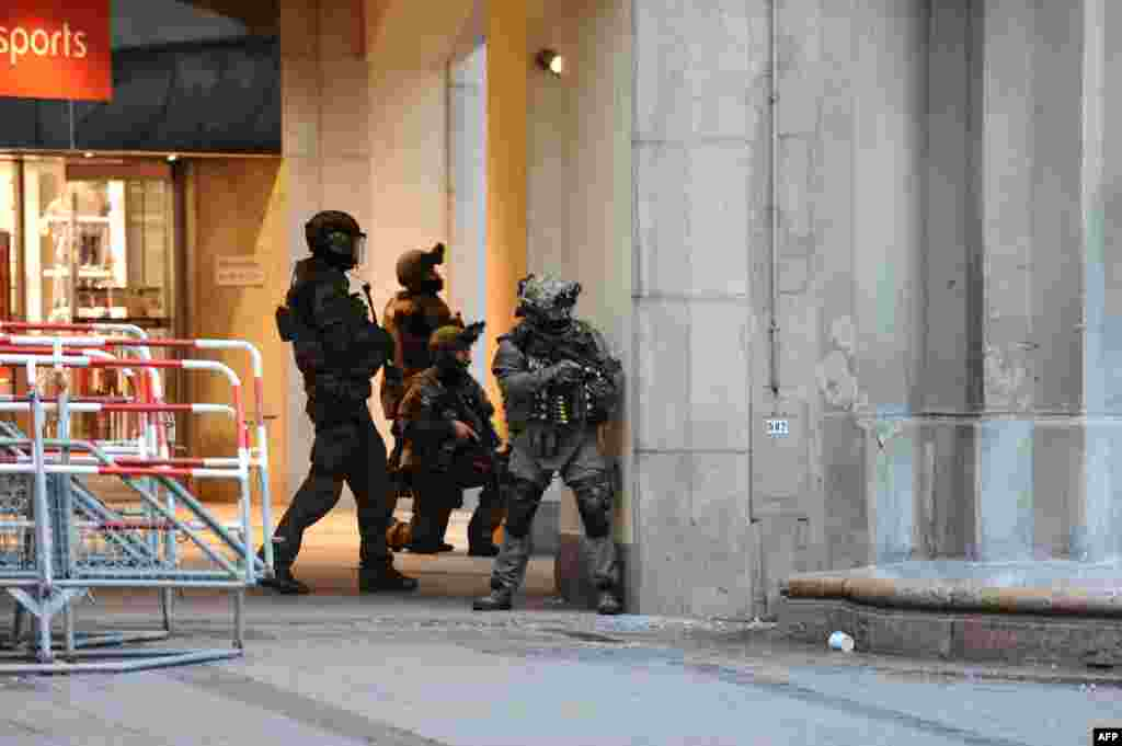Police secures the area of a subway station Karlsplatz (Stachus) near a shopping mall following a shooting in Munich, Germany. Several people were killed in a shooting rampage by a lone gunman in a Munich shopping center, media reports.
