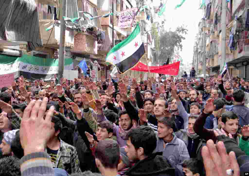 This citizen journalism image provided by Aleppo Media Center, AMC, shows anti-Syrian regime protesters in Bustan Al-Qasr, Aleppo, Syria, March 8, 2013.
