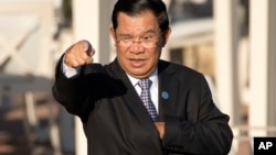 Cambodia's Prime Minister Hun Sen gestures as he arrives for a group photo of leaders at the 11th Asia-Europe Meeting (ASEM) in Ulaanbaatar, Mongolia, Saturday, July 16, 2016. (AP Photo/Mark Schiefelbein)