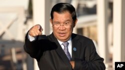 FILE - Cambodia's Prime Minister Hun Sen gestures as he arrives for a group photo of leaders at the 11th Asia-Europe Meeting (ASEM) in Ulaanbaatar, Mongolia, Saturday, July 16, 2016. (AP Photo/Mark Schiefelbein)