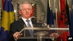 FILE - Kosovo's Skender Hyseni, who at the time was his country's foreign minister, speaks at a news conference during a visit to Tirana, Albania, April 19, 2010.