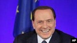 贝卢斯科尼11月4日在法国的一个记者会上