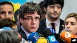 FILE - Fugitive Catalan leader Carles Puigdemont addresses reporters in Brussels, Belgium, Jan. 24, 2018.