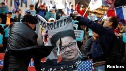 南韓民眾2019年2月26日舉行反平壤示威。(路透社)