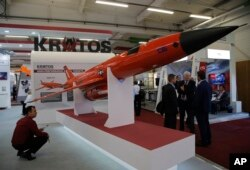 A visitor looks at a BQM-177A Target Drone built by U.S. company Kratos at the Paris Air Show, in Le Bourget, east of Paris, June 20, 2017.