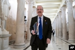FILE - House Foreign Affairs Committee Chair Eliot Engel, D-N.Y., walks through the Hall of Columns at the Capitol as House Democratic chairs gather for a meeting with Majority Leader Steny Hoyer, D-Md., in Washington, March 27, 2019.