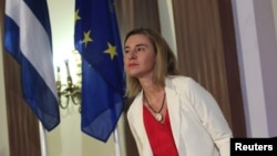 FILE - European Union High Representative for Foreign Affairs Federica Mogherini addresses the media during a news conference in Havana, March 24, 2015.