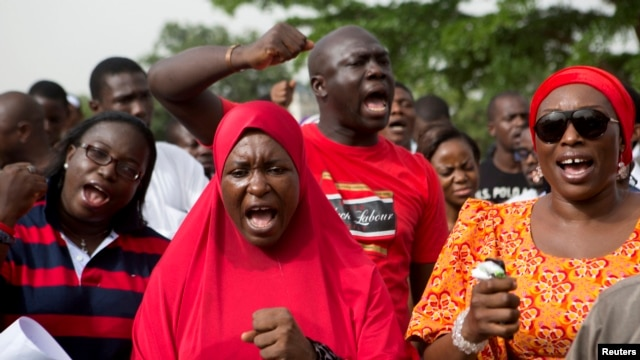 People demand for the release of secondary school girls abducted in the remote village of Chibok, during a protest at Unity Park in Abuja, May 11, 2014.