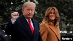 U.S. President Donald Trump walks with first lady Melania Trump while departing for Palm Beach, Fla., from the White House in Washington, Feb. 1, 2019.
