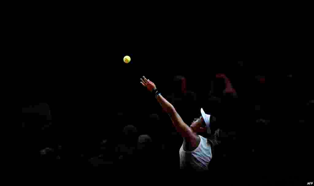 Japan's Naomi Osaka serves to Taiwan's Su-Wei Hsieh during their round-of-16 match at the WTA Tennis Grand Prix in Stuttgart, Germany.