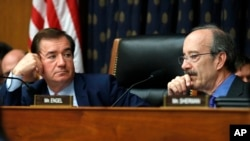 House Foreign Affairs Committee Chairman Ed Royce, R-Calif., left, and the committee's ranking member Rep. Eliot Engel, D-N.Y., listen during testimony during a committee hearing on North Korea sanctions, Sept. 12, 2017, on Capitol Hill in Washington.