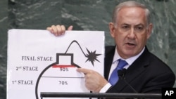 Israel's Prime Minister Benjamin Netanyahu points to a red line he drew on the graphic of a bomb used to represent Iran's nuclear program as he addresses the 67th United Nations General Assembly at the U.N. Headquarters in New York, September 27, 2012.