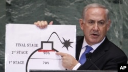 Israel's Prime Minister Benjamin Netanyahu points to a red line he drew on the graphic of a bomb used to represent Iran's nuclear program as he addresses the 67th United Nations General Assembly at the U.N. Headquarters in New York, Sept. 27, 2012.