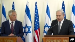 U.S. Secretary of Defense Chuck Hagel, left, listens at a joint press conference with Israeli Prime Minister Benjamin Netanyahu at the latter's office in Jerusalem, April 23, 2013.