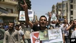 星期五反敘利亞政府的示威者高呼口號