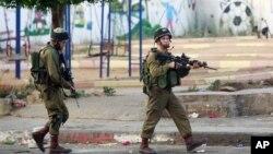 以色列與巴勒斯坦發生衝突後﹐7月2日以色列士兵在西岸加緊戒備。
