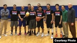 Players for the Cambodia National Basketball Team are pictured with the founders of the USA Cambodia Basketball Association, at Costello Athletic Center in Lowell, Massachusetts, March 12, 2017.