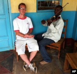 Berklee alumnus Aaron Colverson with a student at Matende High School in Kakamega, Kenya.