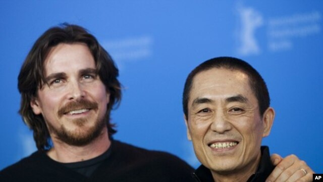 """British actor Christian Bale (L) and Chinese director Zhang Yimou pose during a photocall to promote the film """"The Flowers of War""""  February 13, 2012."""