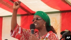 FILE - Grace Mugabe, Zimbabwe's first lady, addresses a rally in Chinhoyi, about 120 kilometers west of Harare, Oct. 2, 2014.