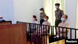 Myanmar's ousted leader Aung San Suu Kyi, former president Win Myint and doctor Myo Aung appear at a court in Naypyitaw, Myanmar May 24, 2021, in this still image taken from video. (MRTV/REUTERS TV/via REUTERS)