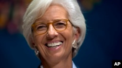 International Monetary Find (IMF) Managing Director Christine Lagarde laughs during a forum in Lima, Peru, Oct. 7, 2015, during the annual meetings of the World Bank Group and IMF.