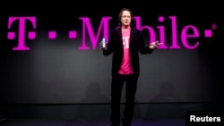 T-Mobile CEO John Legere speaks during a news conference at the 2014 International Consumer Electronics Show in Las Vegas, Nevada, January 8, 2014.
