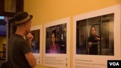 Photo Exhibit Captures Portraits of Migrant Workers
