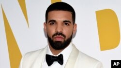 FILE - Canadian rapper Drake arrives at the NBA Awards in New York.