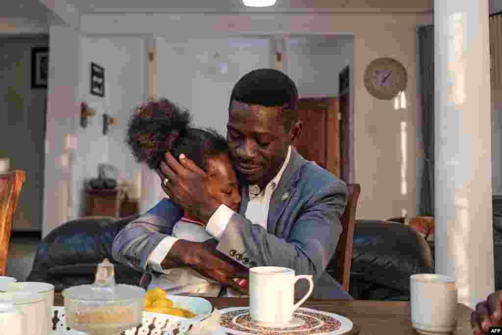 Ugandan pop star and presidential candidate Bobi Wine and his daughter Subi share a moment during breakfast in his home in Kampala.
