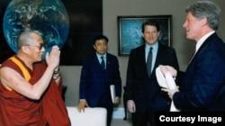 FILE - The Dalai Lama, Lodi Gyari, Al Gore and Bill Clinton in the Office of the Vice President, Washington, April 1993.