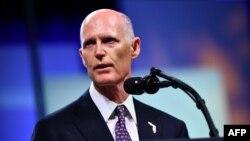资料照片:美国联邦参议员斯科特2018年10月8日担任佛罗里达州长时参加活动发表演说。
