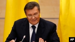 FILE - Ukraine's fugitive President Viktor Yanukovych is seen at a news conference in Rostov-on-Don, Russia, Feb. 28, 2014