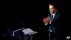"""FILE - Candidate for the left-wing presidential primaries Benoit Hamon delivers a speech during a campaign rally in Paris, France, Jan. 18, 2017. Hamon's push for a """"universal income"""" has catapulted him from obscurity to within reach of the presidency."""