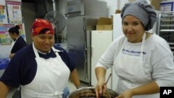 Tiffany Yanaway, 19, (r) and Katara Tyler, 17, are trainees at Sunflower Bakery, which helps people with learning disabilities find jobs in the baking industry.