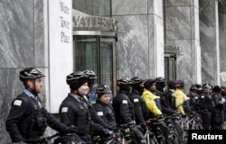 FILE - Chicago police block the main entance to Water Tower Place during a protest march against police violence in Chicago, Illinois, Dec. 24, 2015.