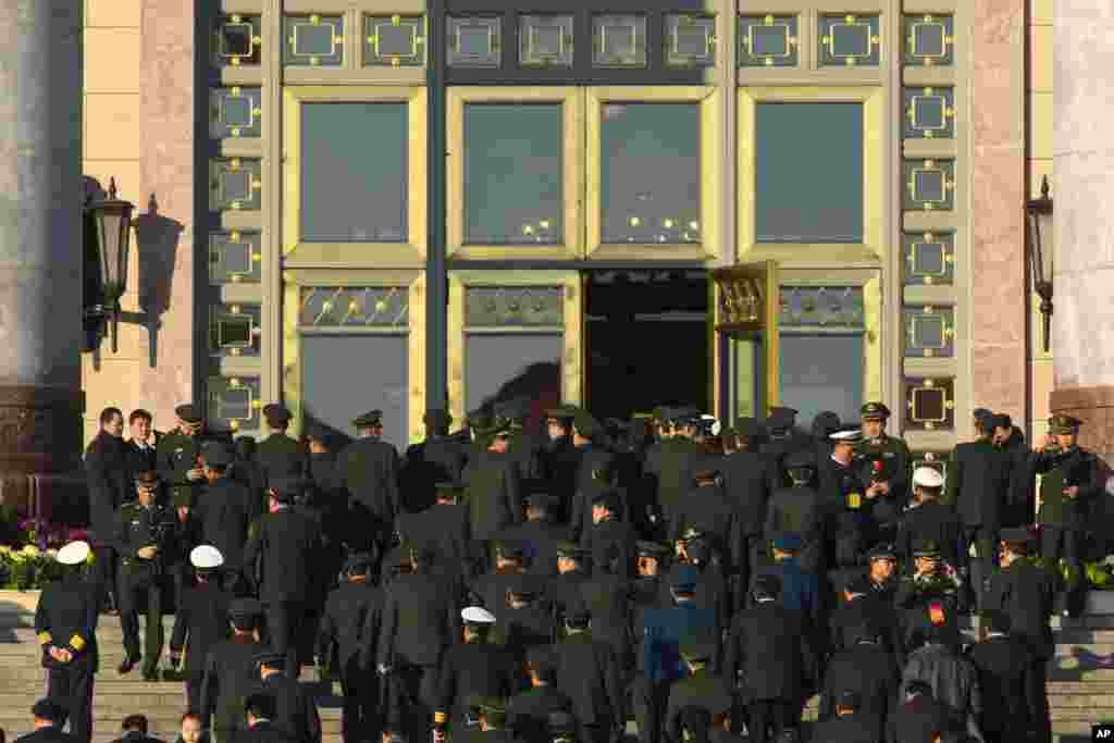 Chinese Communist Party delegates from the People's Liberation Army enter the Great Hall of the People, for the closing ceremony for the 18th Communist Party Congress, Beijing, November 14, 2012.