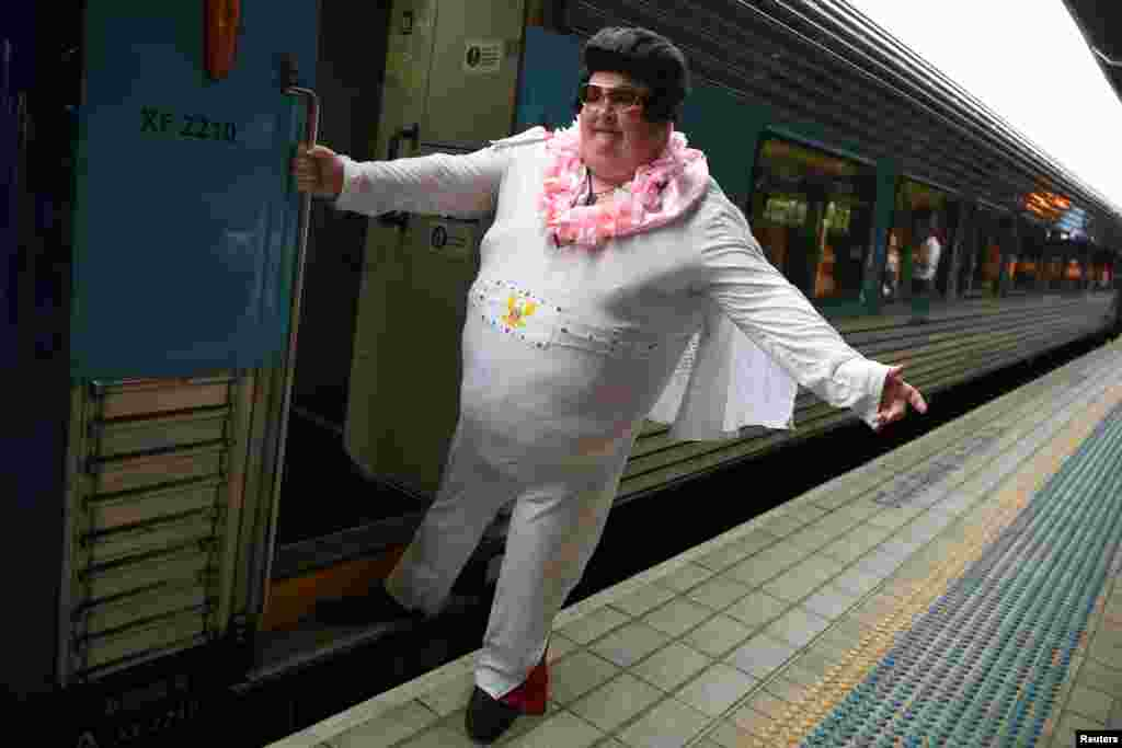 Sean Wright stands for a picture before boarding the Elvis Express, bound for Parkes for the Elvis festival, at Central Station in Sydney, Australia.
