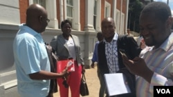 Zimbabwe journalists outside the Constitutional Court after it struck off defamation in the southern African country, Feb. 3, 2016. (Sebastian Mhofu/VOA)