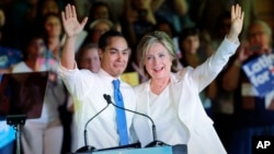 Democratic presidential candidate Hillary Clinton, right, stands with Housing and Urban Development Secretary Julian Castro, left, after she was introduced during a campaign event in San Antonio, Texas, Oct. 15, 2015.
