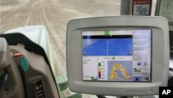 A GPS unit inside a tractor on a farm in Tallula, Illinois