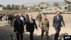 U.S. Defense Secretary Jim Mattis, second left, arrives at NATO's Resolute Support mission in Kabul, Afghanistan on Sept. 7, 2018.