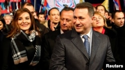 Leader of Macedonian ruling party VMRO-DPMNE and former Prime Minister Nikola Gruevski and his wife, Borkica, greet supporters during an election campaign rally in Ohrid, Macedonia, Nov. 21, 2016.