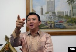 FILE - Then-Jakarta vice governor Basuki Tjahaja Purnama, known by his nickname Ahok, speaks to journalists at his office in Jakarta.