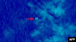 """Handout photo provided by China Center for Resources Satellite Data and Application shows satellite image taken from space, illustrating objects in a """"suspected crash sea area"""" in the South China Sea on March 9, 2014, thought to possibly be from the miss"""